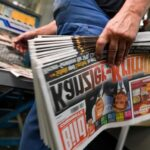 Axel Springer Group fires Bild director for misconduct.